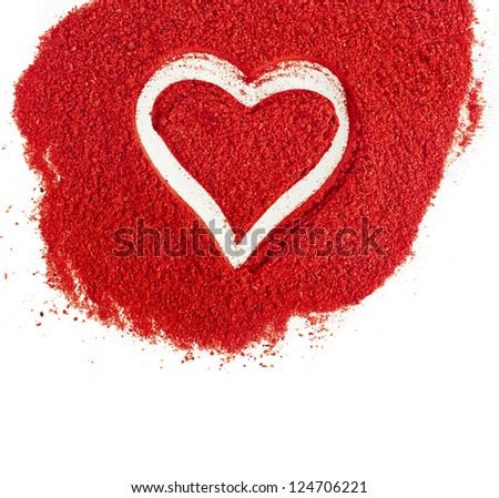 ground paprika with shapes heart sign surface top view on white background - stock photo