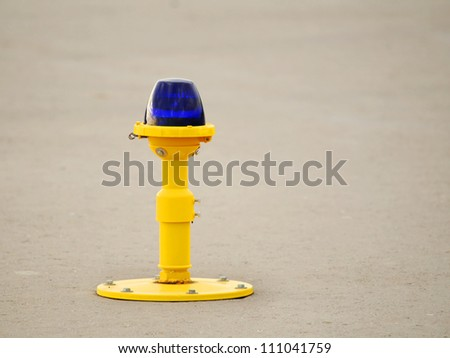 Ground side lamp taxiway at the airport - stock photo