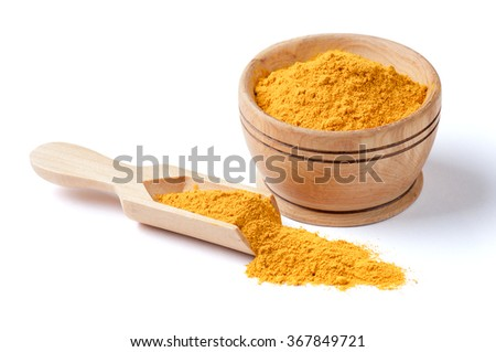Ground turmeric isolated on white - stock photo