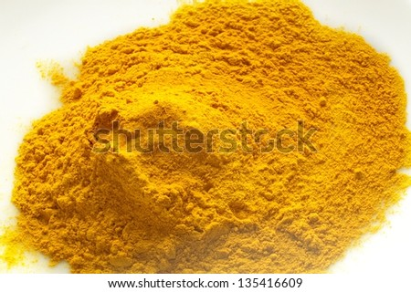 ground turmeric pile n white background - stock photo