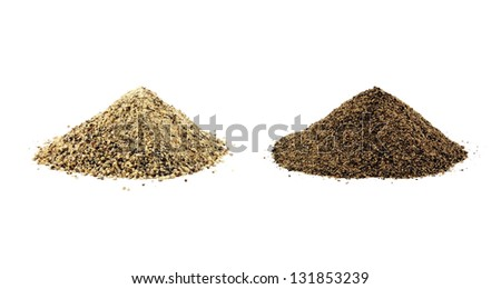 Ground white pepper and black pepper isolated - stock photo