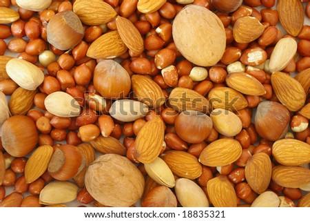 Groundnuts, walnuts; pistachios, hazelnuts and almonds  background - stock photo