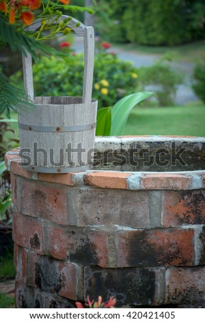 Groundwater wells with antique wooden bucket used to draw water