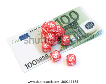Group a percentage dice over a pile of 100 euro's. - stock photo