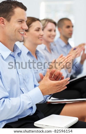 Group applauding business presentation