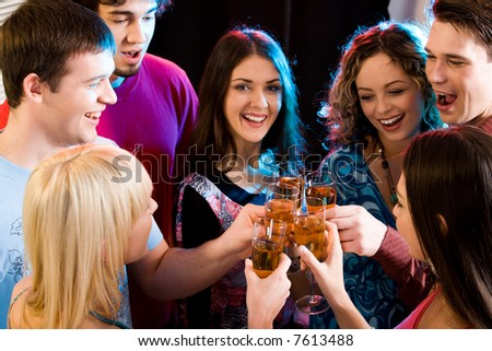 Group are holding the glasses of champagne making a toast - stock photo