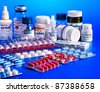 Group blister pack of pills. Remedy on blue. - stock photo