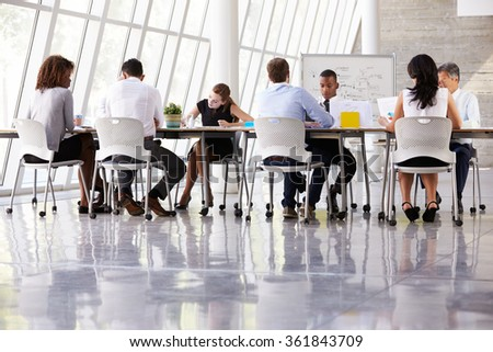 Group Business Meeting Around Table In Modern Office - stock photo