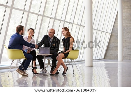 Group Business Meeting In Reception Of Modern Office - stock photo