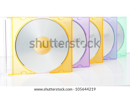 Group CD in colored boxes. On a white background.CD-ROM. - stock photo