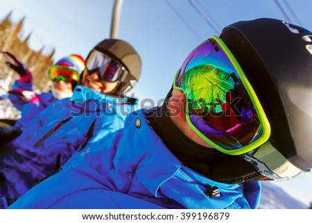 Group cheerful snowboarders on the mountain resort - stock photo