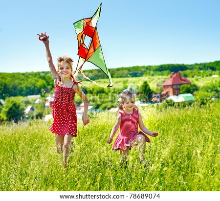 Group children flying kite outdoor. - stock photo