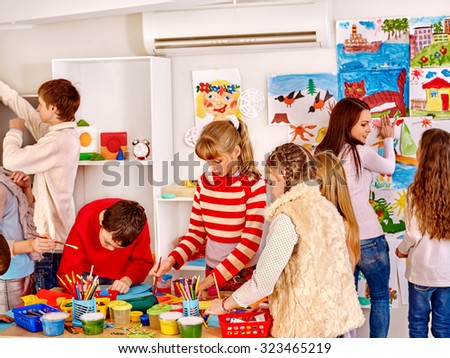 Group children painting at art school. Education. - stock photo