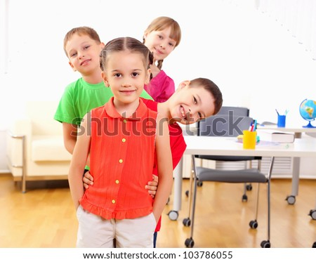 Group classmates standing in a row in the classroom - stock photo