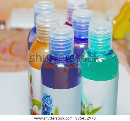 Group cosmetic bottles, cosmetic liquid, shower gels, shampoos, cosmetics and bottles for liquid soap - stock photo