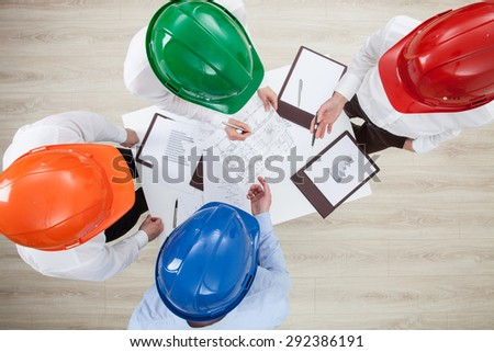 Group discussion in a construction company, view from above - stock photo