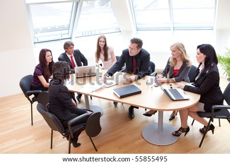 group discussion on a business meeting in a modern office - stock photo