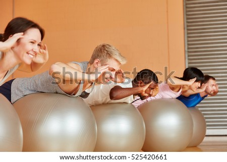 Group during strenuous exercise together in Pilates class