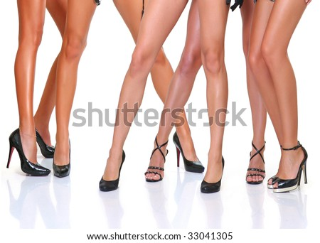 Group from beautiful young women poses in front of the chamber, isolated on a white background, please see some of my other parts of a body images - stock photo