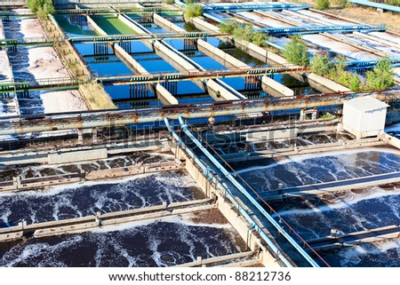Group from the big sedimentation drainages. Water settling, purification in the tank by biological organisms on water station - stock photo