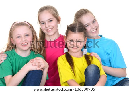 Group funny girls in colorful t-shirts playing together on white background