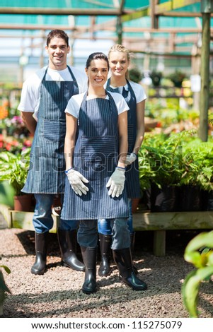 group gardeners portrait in greenhouse - stock photo