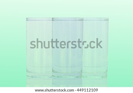 Group Glass of water on green white background - stock photo