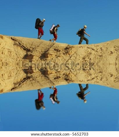 Group going  in sand desert - stock photo