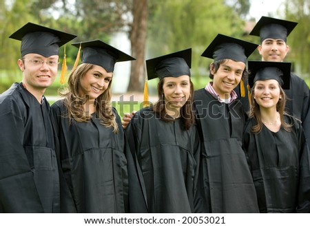 group graduation of students looking very happy - stock photo