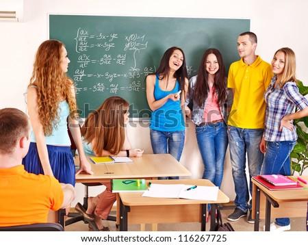 Group happy student in classroom near blackboard. - stock photo