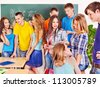 Group happy student near green  blackboard in classroom. - stock photo