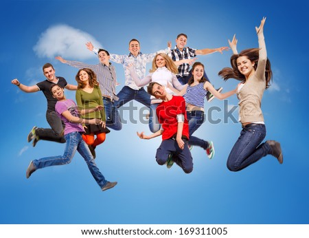 Group happy young people jumping in sky - stock photo