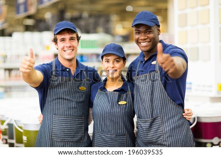 group hardware store workers giving thumbs up - stock photo
