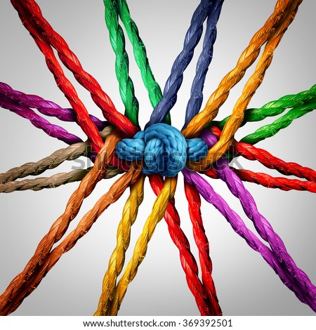 Group holding together as different ropes connected and tied and linked together in the center by a knot as a strong  unbreakable chain and community trust and faith metaphor. - stock photo