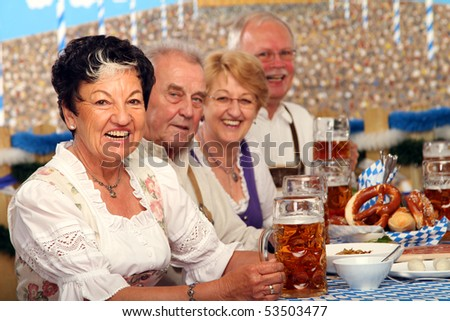Group in beer tent - stock photo