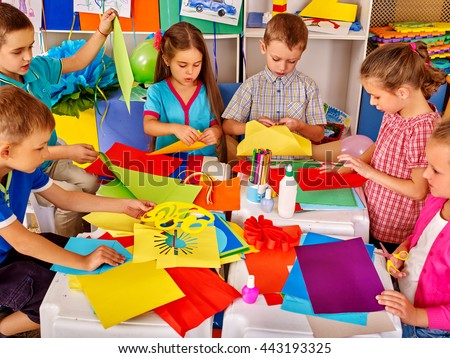Group kids holding colored paper on table in kindergarten . Children writting letter Santa Claus. - stock photo