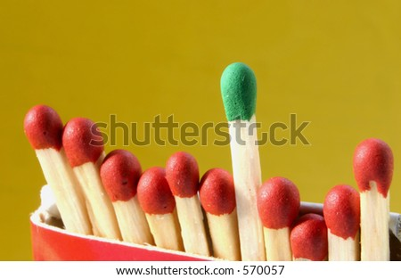 Group leader #2 - focus is set on the green match - stock photo