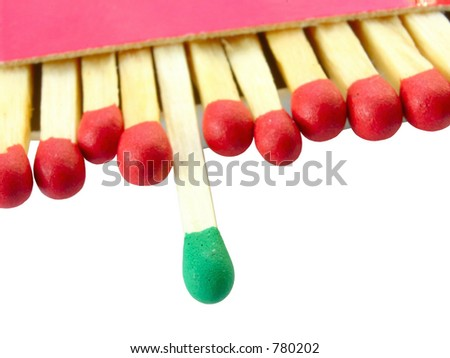 group leader, focus is set on the green match - stock photo