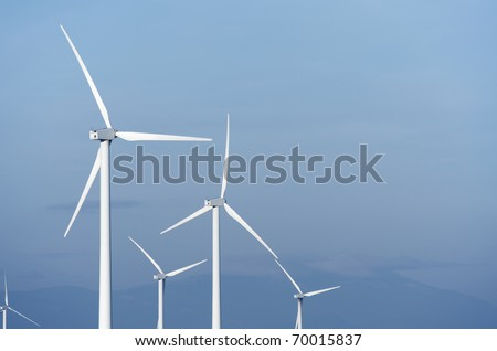 group modern windmills for renewable electric energy production - stock photo