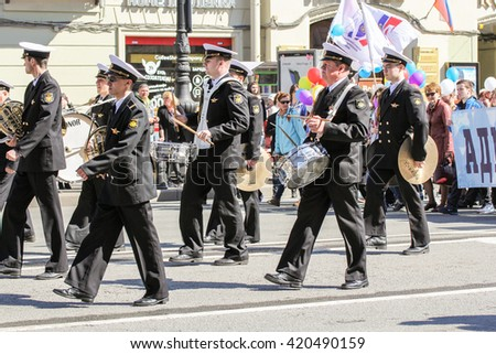 Group naval musicians playing on the go. St. Petersburg, Russia - 1 May, 2016. Day festive demonstration on the Nevsky Prospect in St. Petersburg, the first of May.