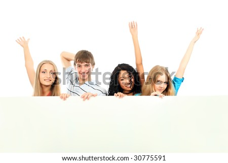 Group of a cheerful young people holding a billboard with empty space for your ad.