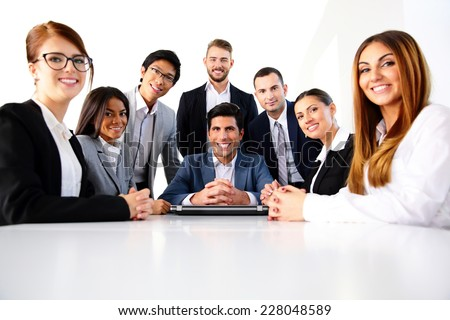 Group of a smiling colleagues in office - stock photo
