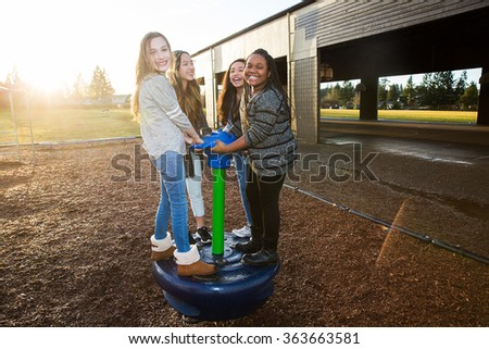 group of active children playing outside at school playground