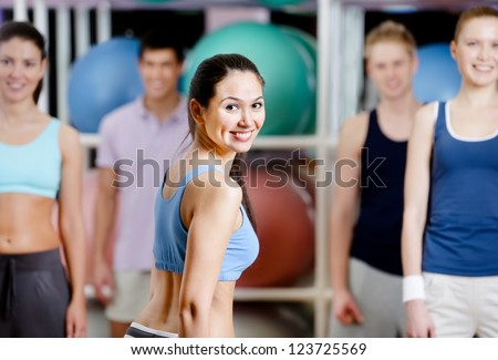 Group of active people in sportswear at the gym in a aerobics class - stock photo