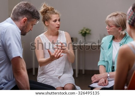 Group of addicted people during psychological therapy - stock photo
