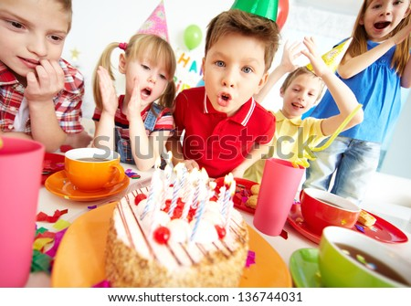 Group of adorable kids having birthday party with festive cake - stock photo