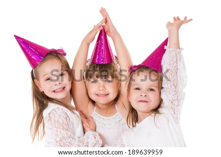 Group of adorable little girls having fun at birthday party  - stock photo
