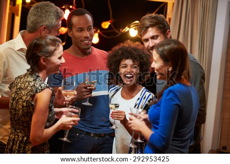 Group of adult friends drinking at a house party - stock photo