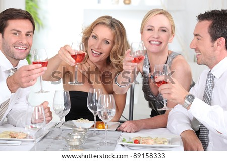 Group of adults having a dinner - stock photo