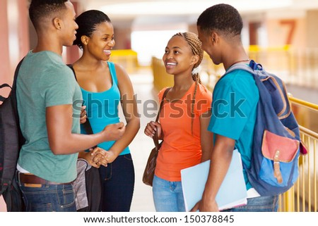 group of african american college students having conversation - stock photo